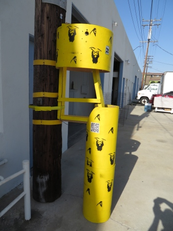 "Alan Nakagawa, ""Title: Moondog Pole,"" 2014. Media: Wood drum, Sonotube, paint, bass strings, electronic, sound loop Dimensions: 4' x 2.5' Installation: Installed onto existing utility pole Venue: Cordary Arts Name of show: Lime Light"
