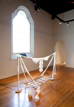 "Jane Gillespie Pryor, ""Cattle Drive,""  2014. Installation view. Plastic, ceramic, plaster, rabbit fur, 4' x 9' x 3'"