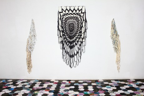 "Thinh Nguyen, ""All American,"" 2013. Installation view. Discarded paintings, thread and yarn, wooden sticks, dimension variable"