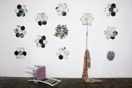 "Thinh Nguyen, ""Death of Authorship,"" 2013. Installation view. Discarded paintings and chair, thread and yarn, dimension variable"